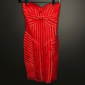 Red cache dress—never worn with tags